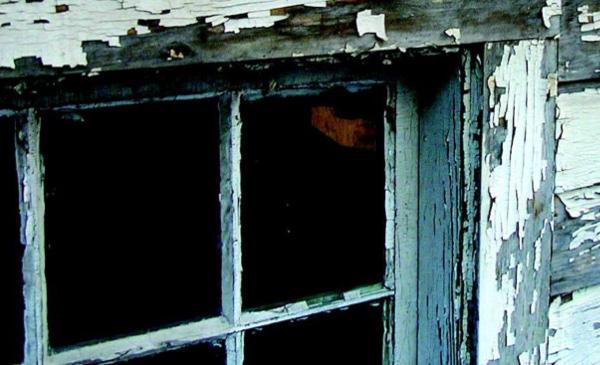 Lead paint flecks off of a windowsill.